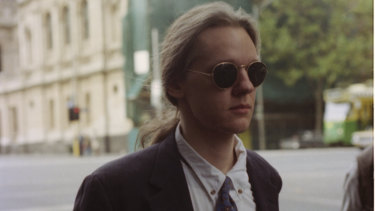 Young hacker: Julian Assange outside court  in 1995 after being accused of hacking into global computer systems.