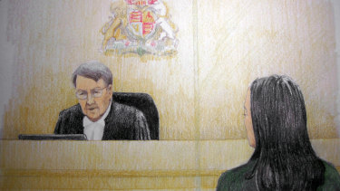 In this courtroom sketch, Meng Wanzhou, right, the chief financial officer of Huawei Technologies, listens to the judge during a bail hearing in Vancouver, Canada.