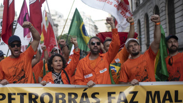 Oil workers march against layoffs at the state oil company Petrobras in Rio de Janeiro, Brazil, on Tuesday.