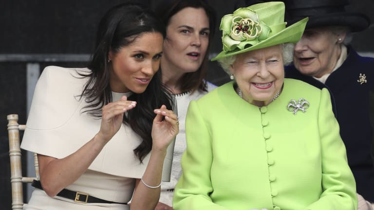 Meghan, the Duchess of Sussex (left), wearing Givenchy, with the Queen last month.