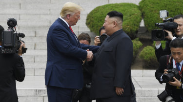 US President Donald Trump shakes hands with North Korean leader Kim Jong-un in the DMZ on Sunday.