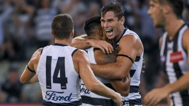 Tom Hawkins celebrates with his Geelong teammates.