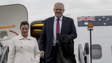 Prime Minister Scott Morrison and his wife Jenny arrive at Farnborough airport in London on Tuesday.