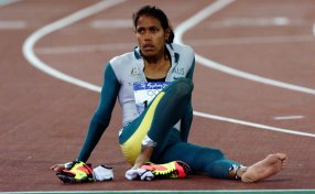 Cathy Freeman takes it in after winning the 400 metres at the Sydney 2000 Olympic Games.
