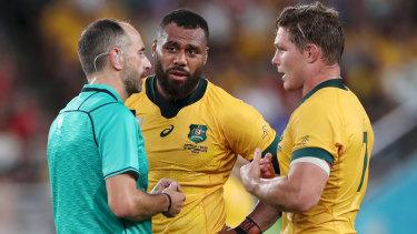 Referee Romain Poite speaks with Samu Kerevi and Wallabies captain Michael Hooper.