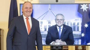 Barnaby Joyce is sworn in as deputy Prime Minister while Scott Morrison looks on via video.