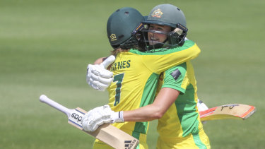 Rachael Haynes and Ellyse Perry celebrate the former's milestone - her first century in any form of the game.