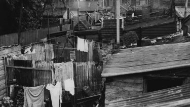 Ramshackle buildings and overcrowded. Fitzroy, 1947.