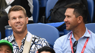 Return serve: Dave Warner, wearing a sling following elbow surgery, and Ricky Ponting at last month's Australian Open.
