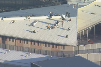 Prisoners have climbed onto the roof of Parklea Correctional Centre