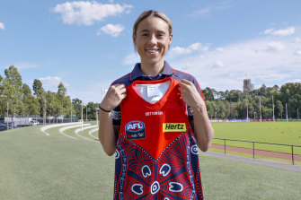 Aliesha Newman with the Indigenous jumper she designed for the Demons last year.