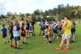 The local junior footy side trains as Buchan recovers from the fires.