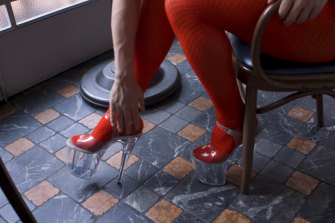 Drag Santa shows off her 20-centimetre heels.