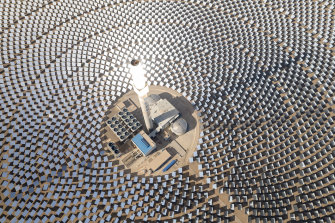 China's super mirror power plant uses 12,000 mirrors to reflect solar power into a central column.