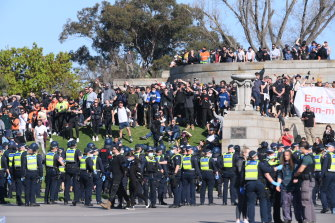 Anti-lockdown protesters face off with Victoria Police at the Shrine of Remembrance in Melbourne on Wednesday.