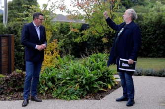 Victorian Premier Daniel Andrews, left, and Mushroom boss Michael Gudinski have teamed up to create a new online space for Australian musicians to connect with audiences.
