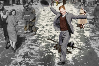 Dancing Man on George Street, Sydney during V Day celebrations. This colourised image was part of the documentary, Australia in Colour.
