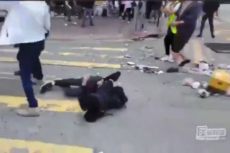 The protester crumples to the ground after being shot.