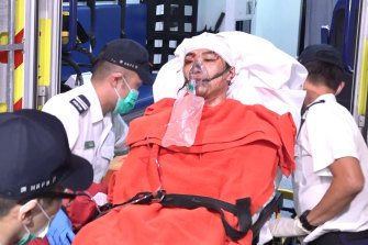 Jimmy Sham arrives at hospital after he was attacked with hammers in Hong Kong.