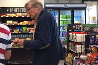 Cardinal George Pell at a service station on Wednesday.