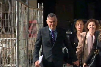 Stephen Kaless with his wife and legal team outside court in August 2020.