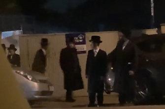Men leaving the secret prayer meeting on Wednesday night.
