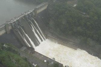 Floodwater spills over Warragamba Dam on Sunday.