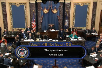 In this image from video, the vote total, 52-48 for not guilty, on the first article of impeachment, abuse of power, is displayed on screen during the impeachment trial against President Donald Trump in the Senate.