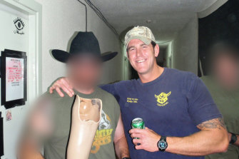 Ben Roberts-Smith with a novelty drinking vessel made from the prosthetic leg of an Afghan man he had killed.