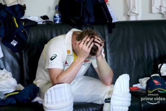 An inconsolable Steve Smith sitting with his head in his hands after being dismissed at a key moment in the game.