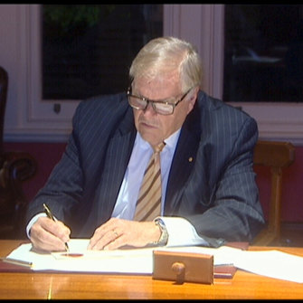 WA Governor Kim Beazley signing the anti-Clive Palmer legislation into law.