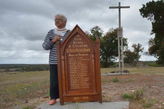 Laura Bell with the roll of honour from St Mary's church, in the ruins of the Lake Condah Mission.