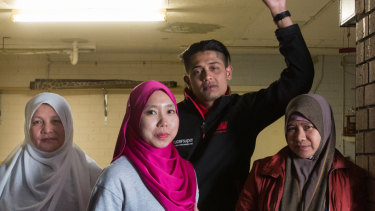 ''I didn't have money to go back also I need to pay rent and transportation to him and the contractor,'' Putri Nazeri (second from left) said.
