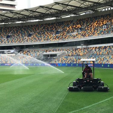 Cutting the AFL-specific grid into the Gabba turf.