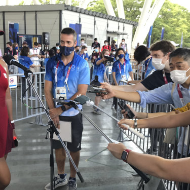 Osaka speaks with journalists after defeating China's Zheng Saisai at the Olympics in Tokyo.