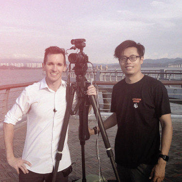Bill Birtles, at left, with Beijing-based cameraman Steve Wang.