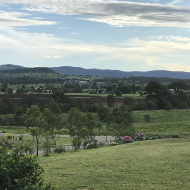Looking over the green Lockyer Valley from the top of the new Grantham, where more than 200 residents have shifted since the 2011 floods.
