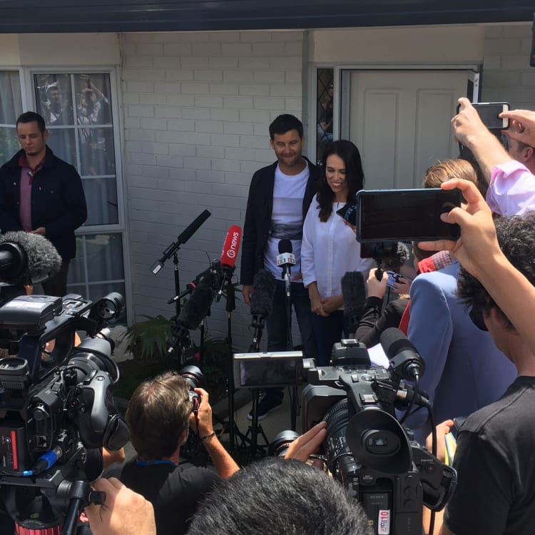 Ardern with partner Clarke Gayford in January, announcing her pregnancy outside their home.