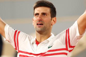 Novak Djokovic celebrates after winning match point during his Men's Singles Semi Final match against Rafael Nadal.