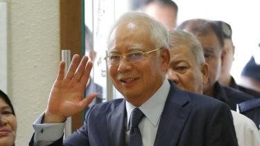 Former Malaysian prime minister Najib Razak walks into a court room at Kuala Lumpur High Court in October.