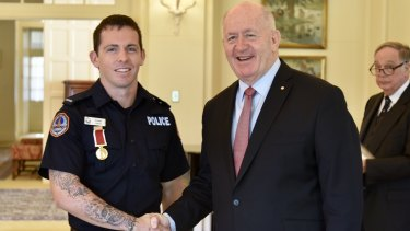 Former Canberra boy Constable Zach Rolfe, now with the Northern Territory police, with Governor-General Sir Peter Cosgrove.