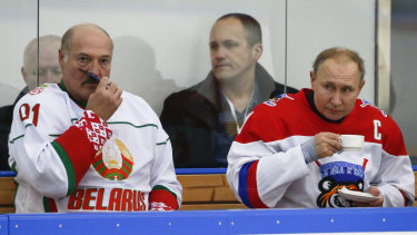Belarusian President Alexander Lukashenko, left, and Russian President Vladimir Putin, take a break during a hockey game in Sochi, Russia.