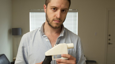 Cody Wilson, the founder of Defense Distributed, shows a plastic handgun made on a 3D-printer at his home in Austin, Texas.