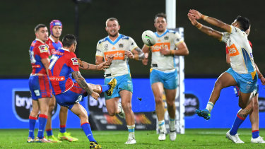 Mitchell Pearce slots the winning field goal in the dying minutes.
