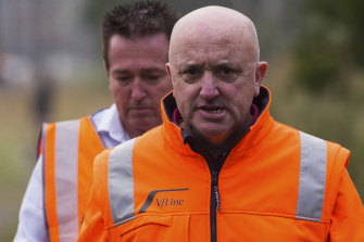 V/Line CEO James Pinder, pictured at the scene of a train derailment in March, has been suspended.