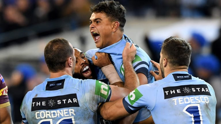 Highs from lows: Latrell Mitchell celebrates with Boyd Cordner and James Tedesco during NSW's 22-12 win.
