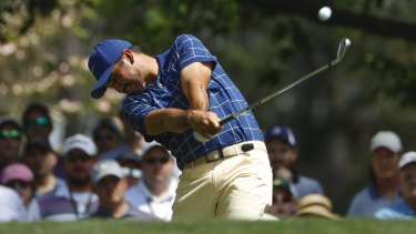 Playing through pain: Jason Day on the fourth hole during his first round at the Masters.
