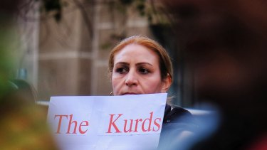 Australia's Kurdish community rallies in front of the State Library in Melbourne on Saturday.