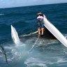 Man swims kilometre in rough seas while woman clings to vessel