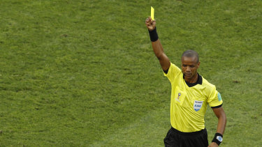 Zambian referee Janny Sikazwe shows a yellow card during the group G match between Belgium and Panama at this year's World Cup in Russia.